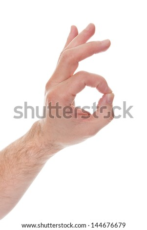 Male Hand Showing Ok Sign Over White Background - stock photo