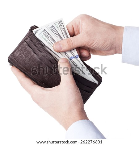 male hand taking dollars from black leather wallet - stock photo