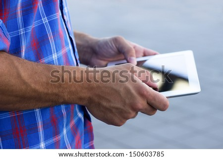 Male hand touching digital tablet pc - stock photo
