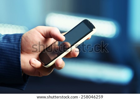 Male hand touching screen phone close-up - stock photo