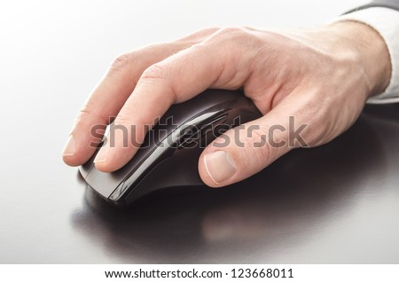 Male hand using a computer mouse.