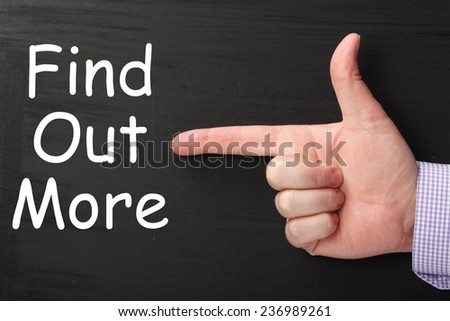 Male hand wearing a business shirt pointing a finger at the phrase Find Out More written on a blackboard - stock photo
