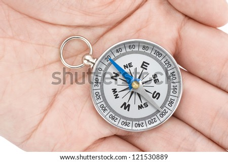Male hand with a compass, close-up shoot - stock photo