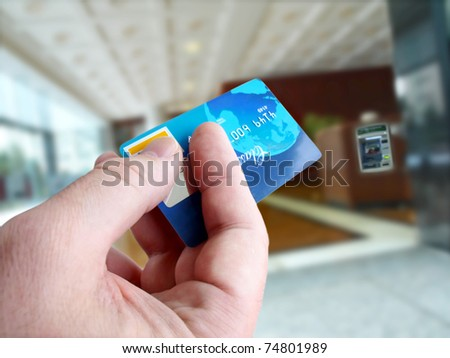 Male hand with credit card - stock photo
