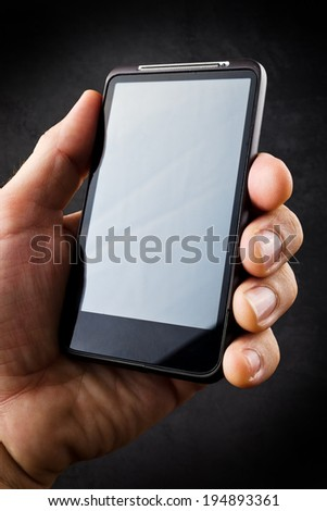 Male Hand with mobile smart phone. New technology concept for e-mails, social networking, wireless internet and information era. - stock photo