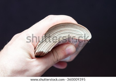Male hand with money, close up, selective focus - stock photo