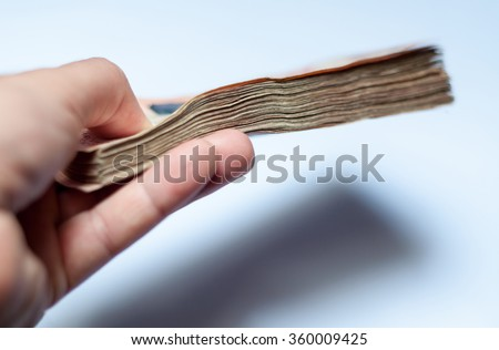 Male hand with money, close up, selective focus