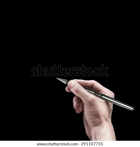 male hand with pen isolated on black background  - stock photo