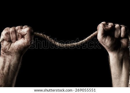 Male hand with rope on black background. Conception aggression - stock photo