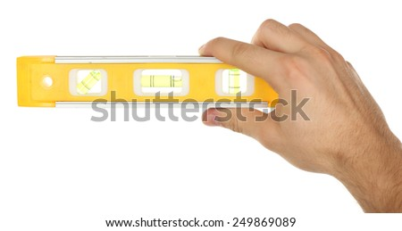Male hand with ruler level isolated on white - stock photo
