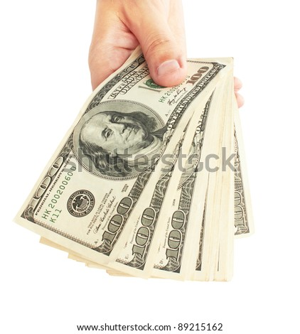 Male hand with stack of dollars isolated on white