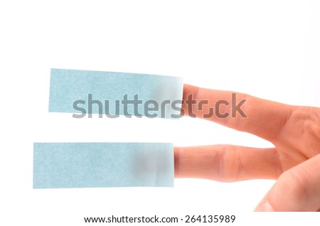Male hand with two blue sticky notes on a white background - stock photo