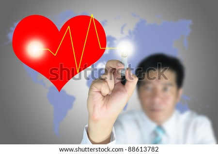 Male hand write heart and heart pulse on touch screen - stock photo