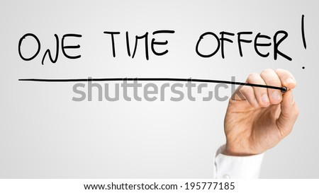 Male hand writing commercial sign One time offer on virtual screen. - stock photo