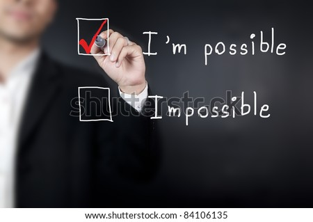 "Male hand writing "" I'm possible "" in a whiteboard - stock photo"