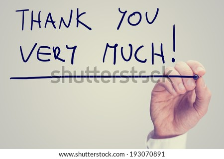Male hand writing phrase Thank you very much on virtual interface, vintage effect toned image. - stock photo
