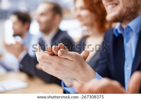 Male hands applauding after presentation of project at conference - stock photo