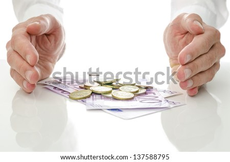 Male hands around Euro banknotes and coins. Concept of help and solution to economic crisis. - stock photo