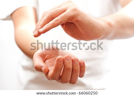 Male hands as if holding something - open space between them - stock photo