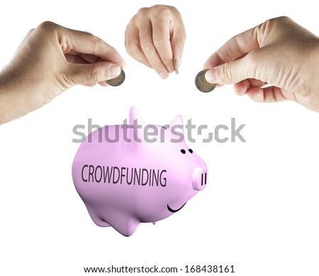 "Male hands bringing money to a piggy bank with word ""crowdfunding"" on the side - stock photo"