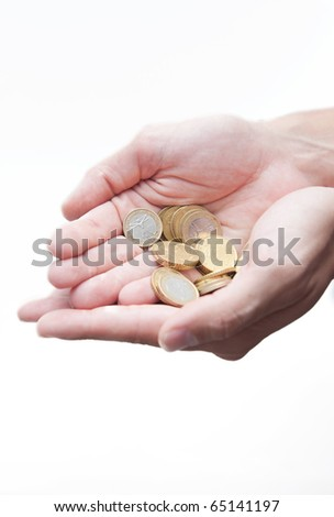 Male hands full of euro coins isolated on white - stock photo