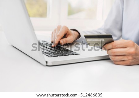 Male hands holding credit card and using laptop. Online shopping concept
