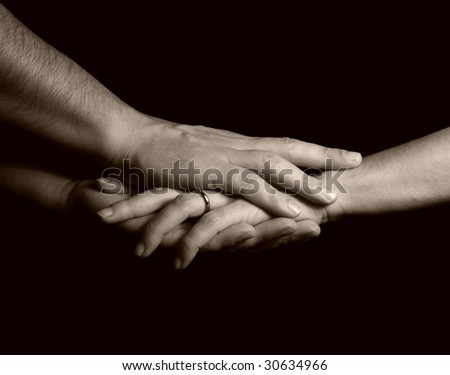 male hands holding female hand - stock photo