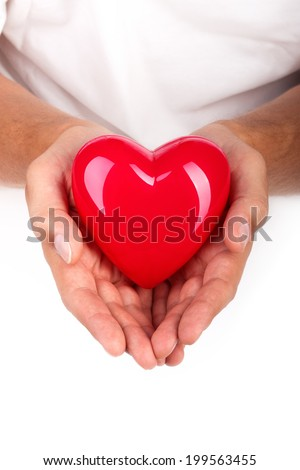 Male hands holding red heart. Health insurance or love concept