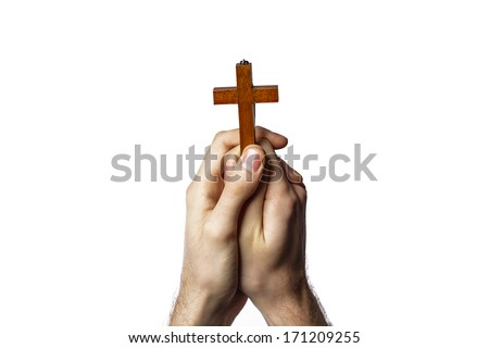 Male hands holding wooden cross on white background - stock photo