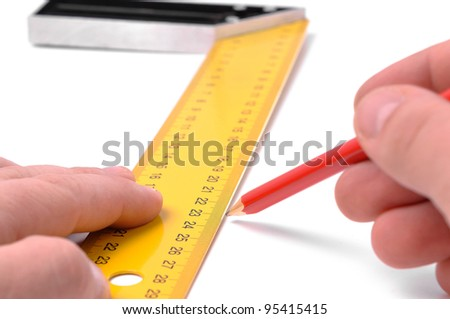male hands holds pencil and metal angle with measure