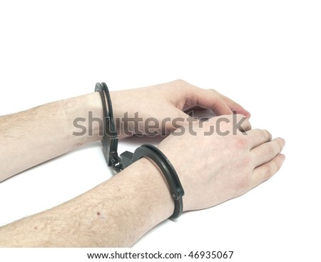 Male hands in handcuffs - stock photo