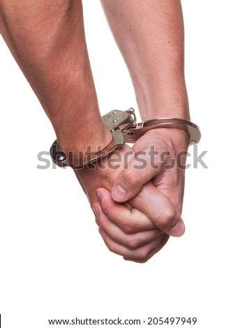 male hands in police handcuffs showing gesture isolated on white background - stock photo