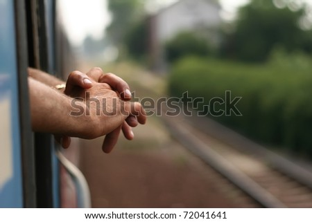 male hands interlocking his fingers. - stock photo
