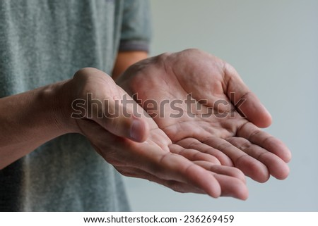 Male hands is holding something - stock photo