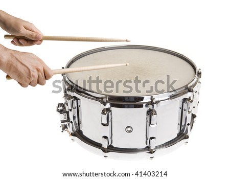 Male hands playing big metal snare drum isolated on white with sticks - stock photo