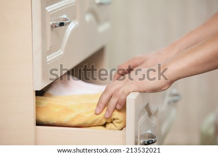 Male hands removed from the dresser towel