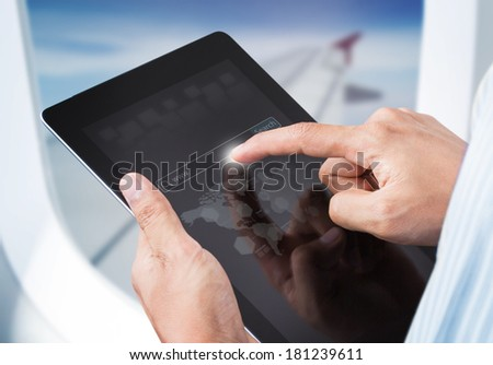 Male hands touching digital tablet with search engine in airplane, Social network concept - stock photo