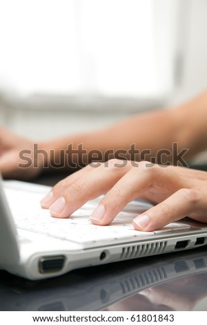 Male hands typing on a keyboard - stock photo