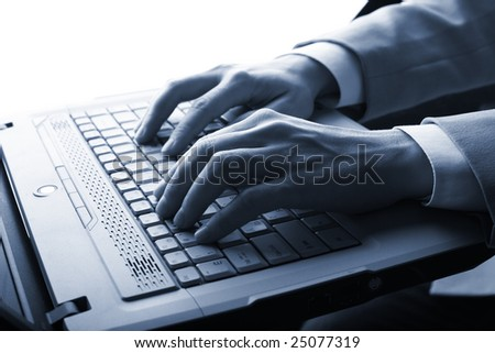 male hands typing on a laptop
