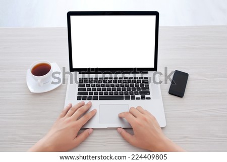 male hands typing on a laptop keyboard in the office - stock photo