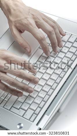 Male hands using keyboard of a laptop