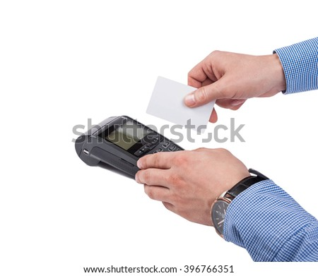 Male hands with blue sleeves swipe blank white credit card over card machine or pos terminal isolated on white background