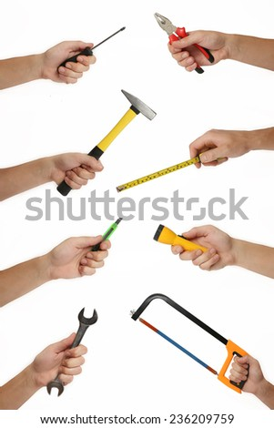 Male hands with lots of house improvement tools on white, Hand holding tools: hammer, pliers, tape measurer, wrench, screwdriver, scalpel, bucksaw, bradawl, flashlight...isolated on hite - stock photo
