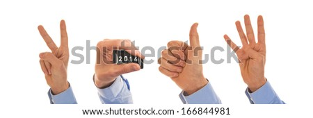 Male hands with pedometer display figuring the year 2014 - stock photo