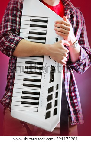 Male hands with synthesizer in studio - stock photo