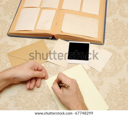 male hands write letter - stock photo