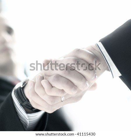 Male Handshake (Attention! Low depth of field!) - stock photo