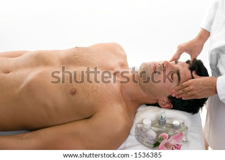 Male having a relaxing head massage - stock photo