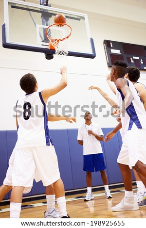 Male High School Basketball Team Playing Game - stock photo