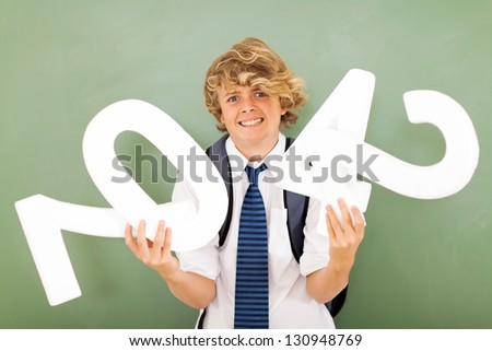 male high school student is struggling with maths subject - stock photo